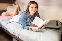 Student with book in residence hall