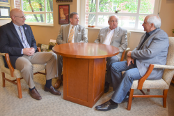 From left, EKU Vice President for Development and Alumni Relations Nick Perlick, President Michael Benson, retired EKU Football Coach Roy Kidd, and Jim Guice.  (Photo by Sarah Bucknam)